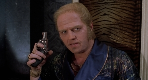 The antagonist Biff holds all the power and leverage with his pistol.